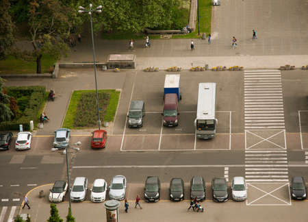 busses: Busses and cars on warsaw downtown parking, aerial view, Poland