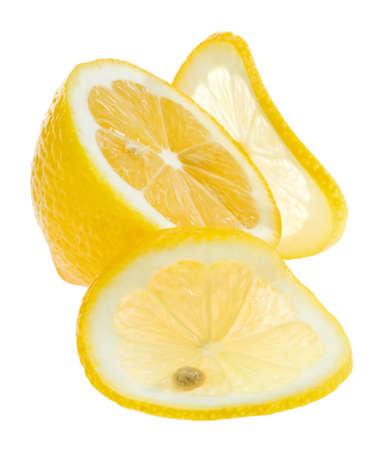 Cut yellow lemon isolated on white