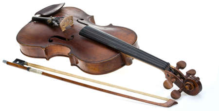 Old violin with fiddlestick isolated on white