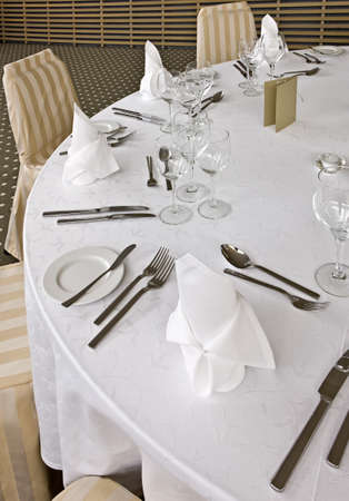 glases: Knife, fork, spoon, plate and glases on a table