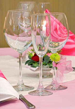 Wedding table decorated with bouquet and candles photo