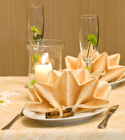 Wedding table decorated with flower and candles Stock Photo