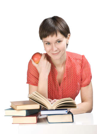 Young women with apple and books on white background
