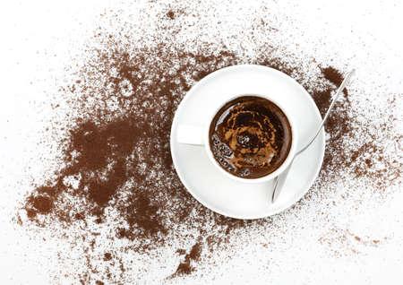 Eine Tasse Kaffee und Kaffee-Spritzer Lizenzfreie Bilder