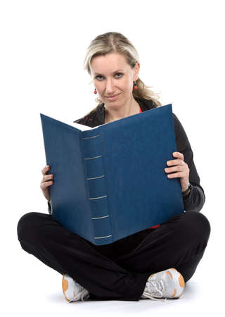 sitt: Young women with book sitt on the floor. White background
