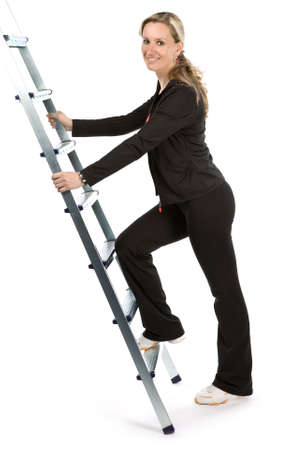 Young women with sportswear on ladder. White background
