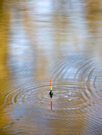 bobber: Bobber sign in lake waves