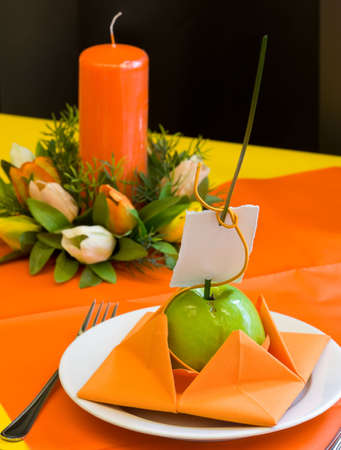 Decorated wedding table. Green apple with name card photo