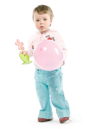 Child with pink jacket, pink balloon, wooden flower. Isolated on white Stock Photo - 4834435