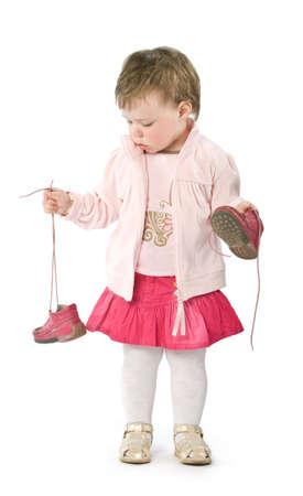 Kind mit rosa Jacke. Isolated on white Lizenzfreie Bilder