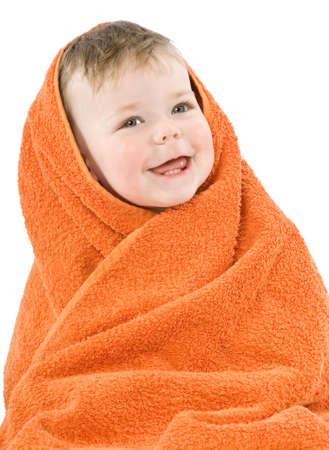 Child in orange towel. Joyful smile. Isolated. Stock Photo