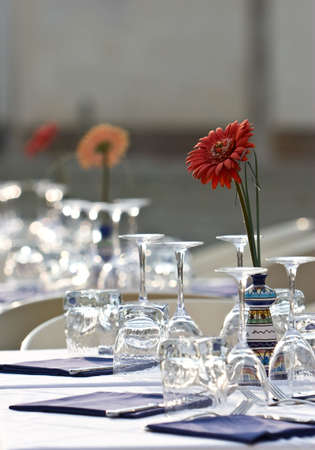 Covered with a table. Outdoor restaurant. Aster in vase