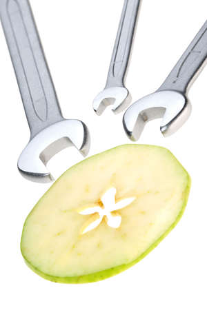 Cut apple and wrench isolated. photo