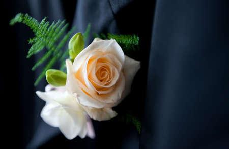 buttonhole: Closeup shot of flower in buttonhole. Groom suit