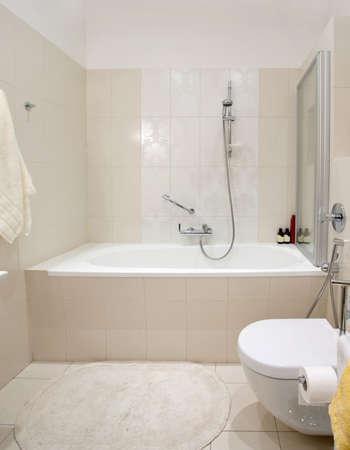 Modern domestic bathroom. Ceramic bath with shower. photo