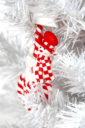 artifical: White Christmas tree decorated. Artifical. Red toy Stock Photo