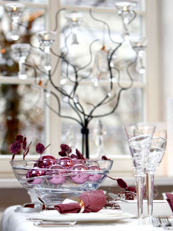 Christmas table decoration. Ball in the glass bowl.