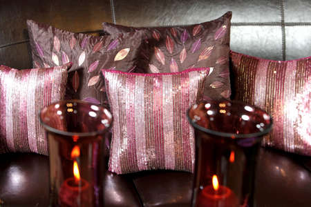 Five pink pillows decorated on the leather sofa photo