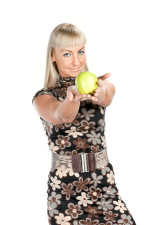 Blonde woman in flowered dress with green apple isolated Stock Photo - 6089733