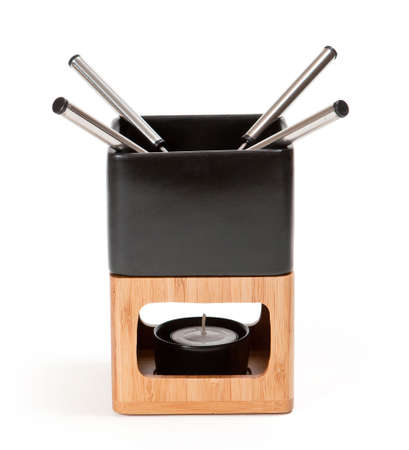 Fondue set for four, isolated. Clipping path photo