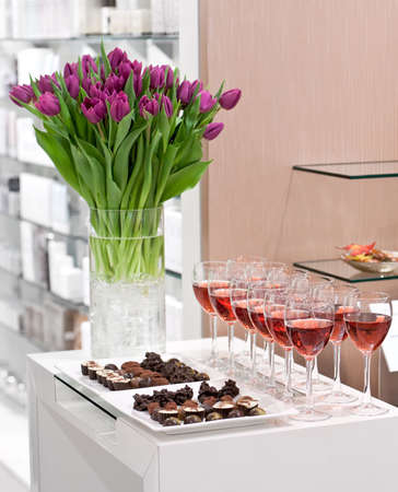 Chocolate candy set, glasses of rose wine, bouquet of tulips photo