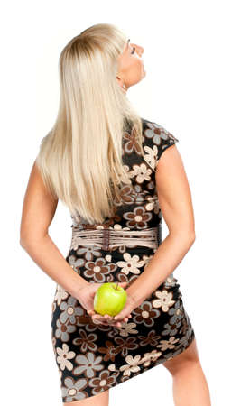 Blonde woman in flowered dress with green apple isolated photo