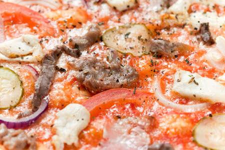 Macro shot of italian pizza with ham, chicken and cucumber Stock Photo - 6217336