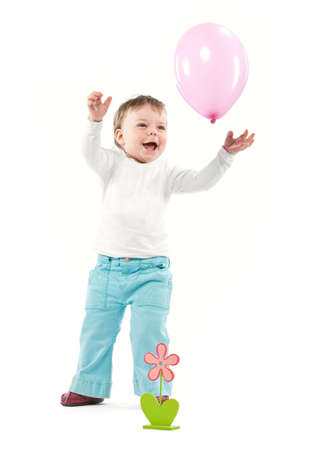 Girl play with pink balloon isolated. Study shot photo