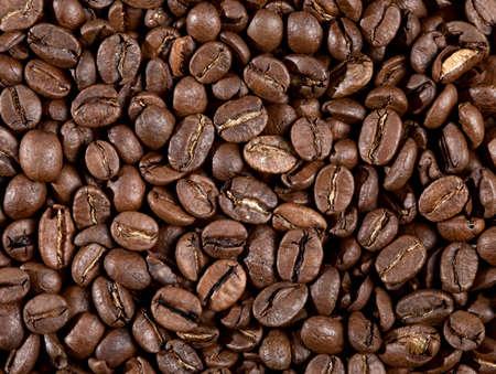 Macro shot of roasted coffee beans. Arabica coffee