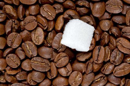Piece of sugar on the roasted coffee beans