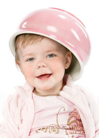 Baby girl with pink potty on white background photo