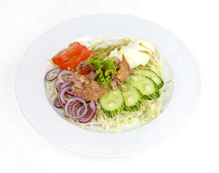 cod liver: Salad with cod liver, tomato, cucumber, onion, egg and cabbage Stock Photo