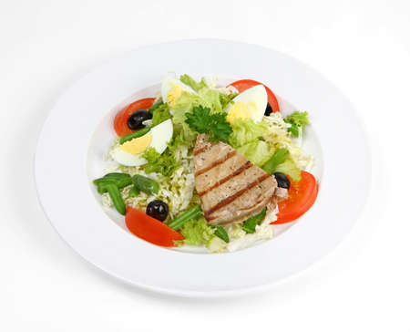 Salad with grilled tuna, eggs, tomatoes, olives and asparagus Stock Photo
