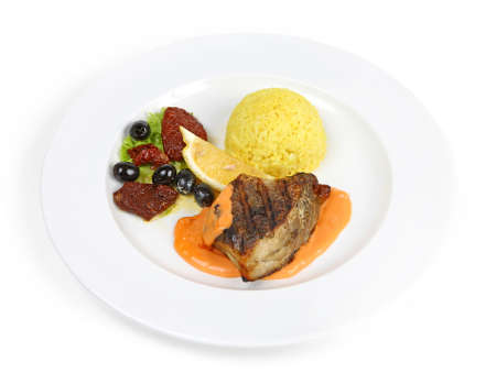 Grilled fish steak with rice and dried tomatos