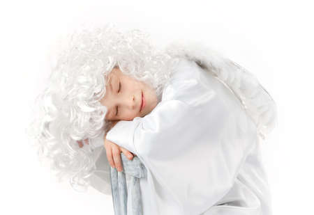 White angel with white wings sleeping isolated photo