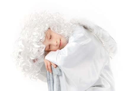 peruke: White angel with white wings sleeping isolated
