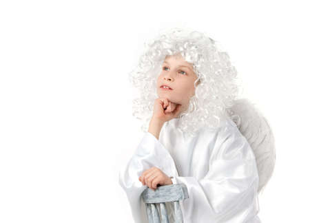 peruke: White angel with white wings dreaming isolated Stock Photo