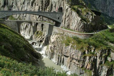 Bridge near Andermatt on mount Gotthard on Swiss alps Stock Photo
