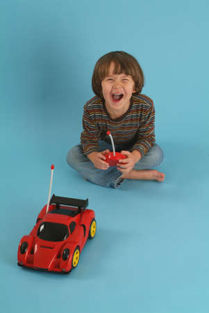 boy playing with a remote controlled car photo
