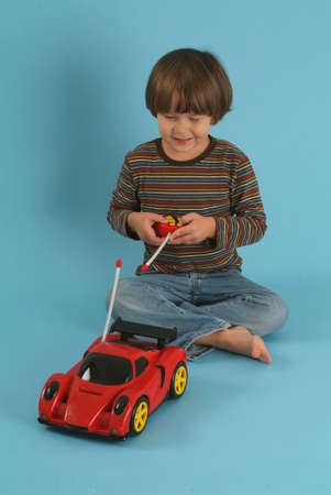 boy playing with a remote controlled car Stock Photo