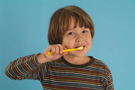 boy brushing his teeth photo