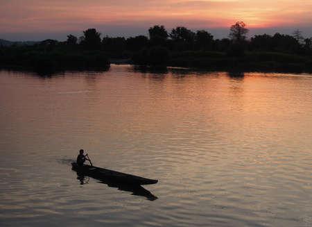 det: Fisherman at sunset on river Mekong at Don Det island, Laos Stock Photo