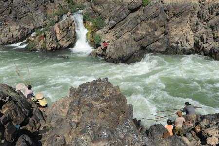 tat: Fisherman at Tat Somphamit waterfall at Kon Khon on Laos