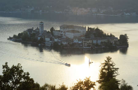 Sunset at lake Orta with the island of San Giulio photo