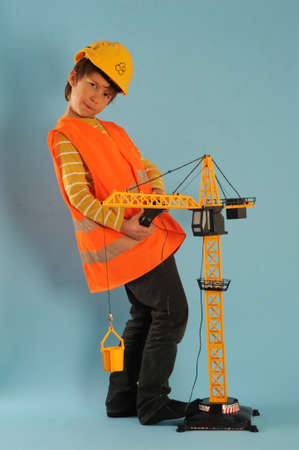 Boy playing with a crane making construction photo