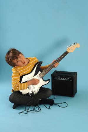 Boy playing a electric guitar