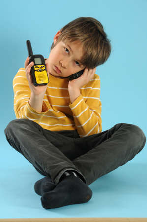 walkie talkie: Boy talking with a walkie talkie