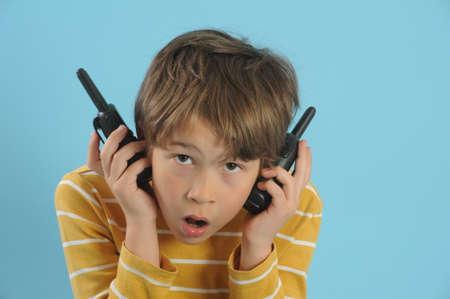 walkie talkie: Boy talking with a walkie talkie