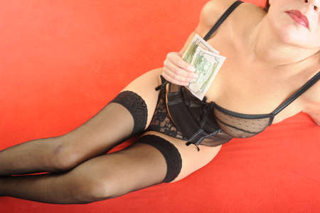 Prostitute cashing money for her performance  photo