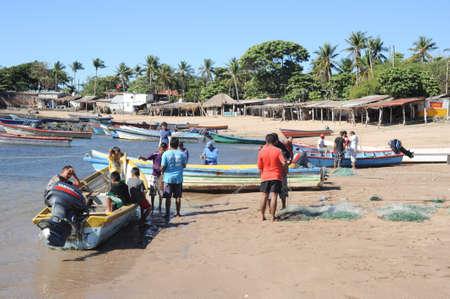 Lobster fisherman on the beach of Los Cobanos on El Salvador